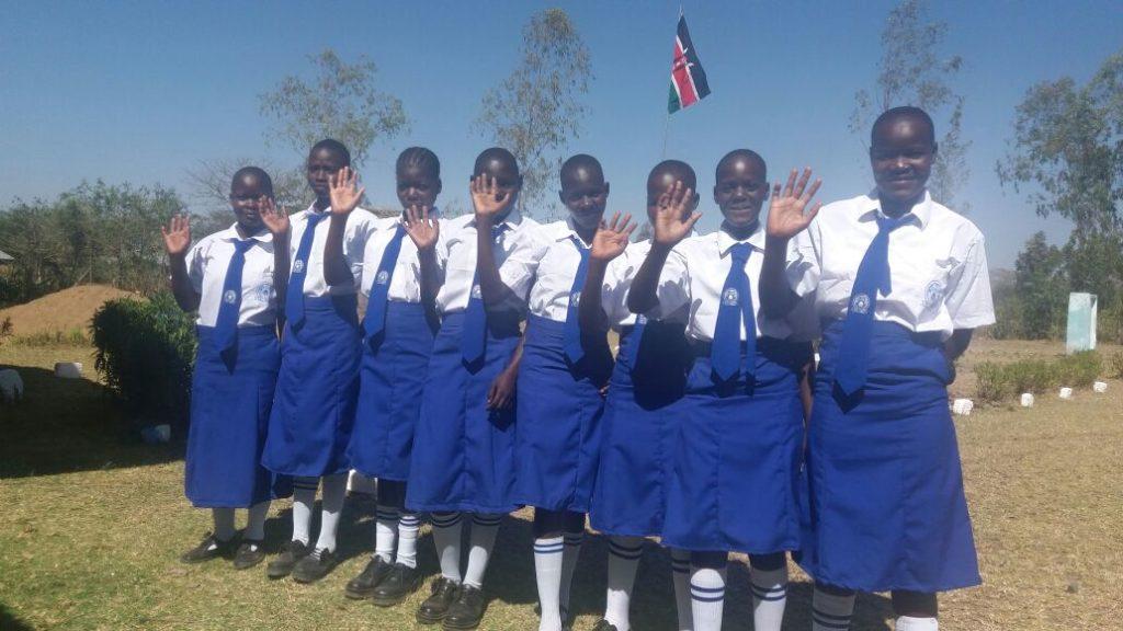 Image of high school girls waving